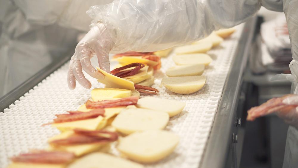 hand assembling food